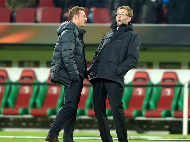 Markus Weinzieri and Jurgen Klopp share a joke during the Europa League game between Augsburg and Liverpool on February 18, 2016