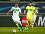 Max Kruse of Wolfsburg is pursued by Stefan Mitrovic of Gent in the Champions League on February 17, 2016