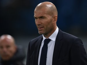 Zinedine Zidane looks on during the UEFA Champions League match between AS Roma and Real Madrid on February 17, 2016