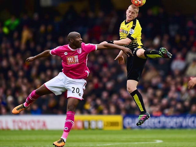 Ben Watson of Watford and Benik Afobe of Bournemouth compete for the ball on February 27, 2016