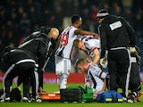 Chris Brunt is taken off by a stretcher after injury during the Premier League match between West Bromwich Albion and Crystal Palace at The Hawthorns on February 27, 2016