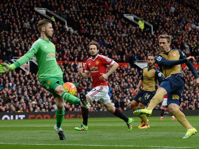 David de Gea blocks an effort from Nacho Monreal during the Premier League game between Manchester United and Arsenal on February 28, 2016