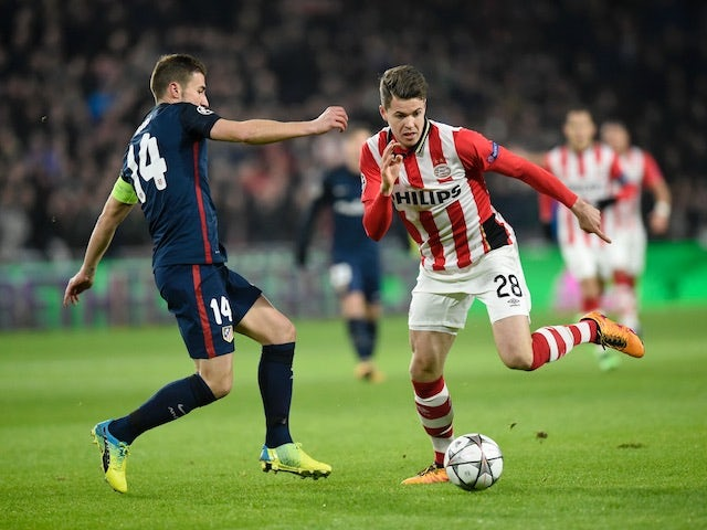 Atletico Madrid's Gabi and Marco van Ginkel of PSV Eindhoven battle for possession during the Champions League last-16 first leg on February 24, 2016