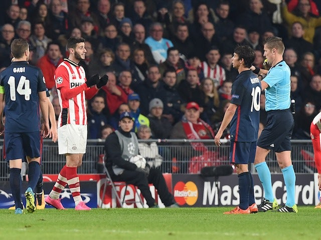 PSV Eindhoven's Gaston Pereiro is sent off during the Champions League last-16 first leg against Atletico Madrid on February 24, 2016