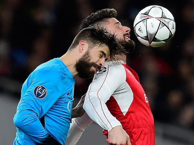Gerard Pique and Olivier Giroud fulfil NW's fantasy during the Champions League game between Arsenal and Barcelona on February 22, 2016
