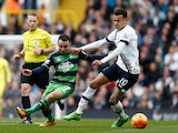 Leon Britton and Dele Alli in action during the Premier League game between Tottenham Hotspur and Swansea City on February 28, 2016