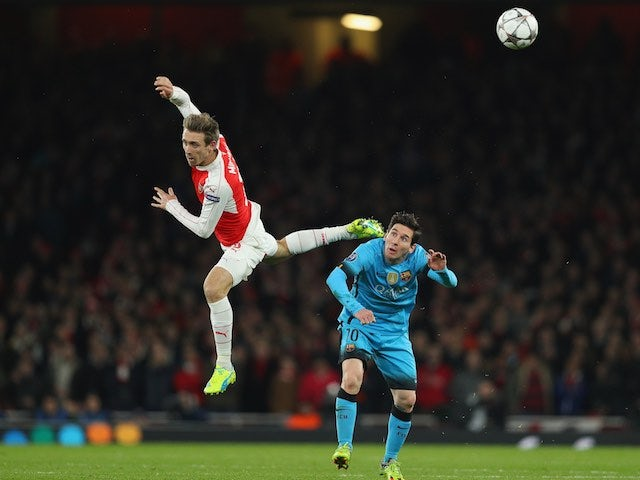 Lionel Messi and Nacho Monreal in action during the Champions League game between Arsenal and Barcelona on February 22, 2016