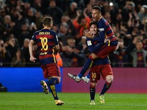 Messi, Pique net as Barca beat Sevilla