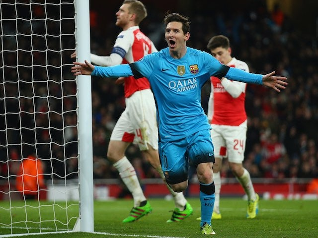 Lionel Messi celebrates scoring the opener during the Champions League game between Arsenal and Barcelona on February 22, 2016
