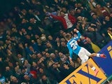 Lorenzo Insigne rises like a phoenix after scoring during the Serie A game between Napoli and Milan on February 22, 2016