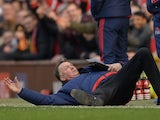 Louis van Gaal dives to the ground during the Premier League game between Manchester United and Arsenal on February 28, 2016