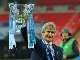 Manuel Pellegrini celebrates with the League Cup trophy on February 28, 2016