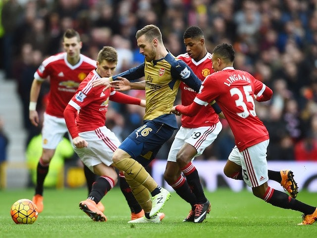 Marcus Rashford goes after Aaron Ramsey during the Premier League game between Manchester United and Arsenal on February 28, 2016