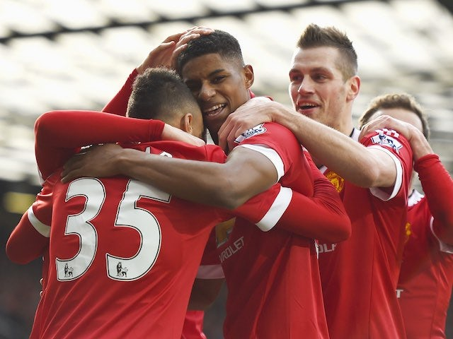 Marcus Rashford celebrates with teammates during the Premier League game between Manchester United and Arsenal on February 28, 2016