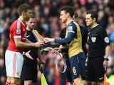Michael Carrick and Laurent Koscielny exchange rainbow laces prior to the Premier League game between Manchester United and Arsenal on February 28, 2016