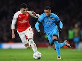 Neymar and Alex Oxlade-Chamberlain during the Champions League game between Arsenal and Barcelona on February 22, 2016