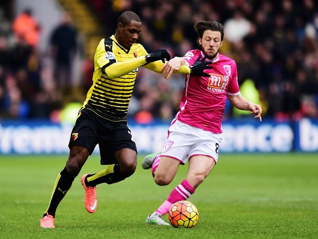 Odion Ighalo of Watford and Harry Arter of Bournemouth compete for the ball on February 27, 2016