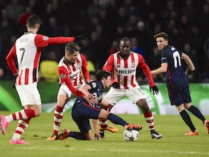 Atletico Madrid's Oliver Torres fights for possession against PSV Eindhoven  during the Champions League last-