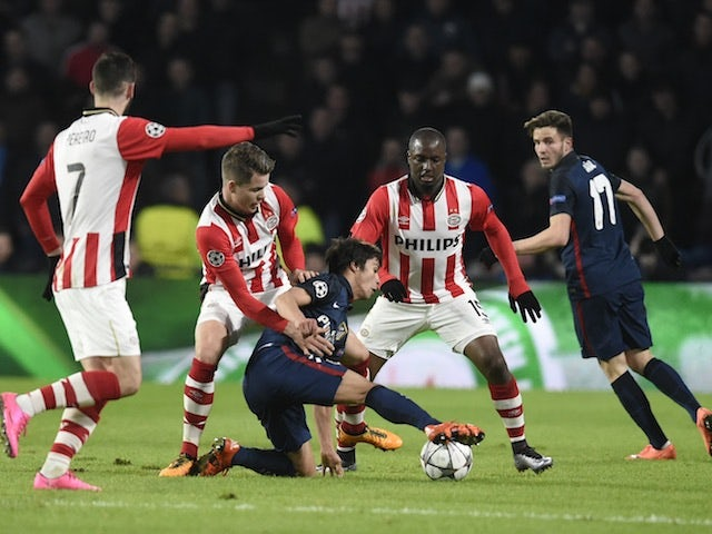 Atletico Madrid's Oliver Torres fights for possession against PSV Eindhoven during the Champions League last-16 first leg on February 24, 2016
