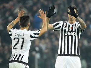 Paulo Dybala celebrates scoring during the Champions League game between Juventus and Bayern Munich on February 22, 2016
