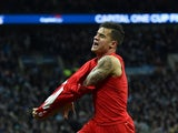 Philippe Coutinho celebrates scoring during the League Cup final between Liverpool and Manchester City on February 28, 2016