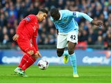 Roberto Firmino and Yaya Toure in action during the League Cup final between Liverpool and Manchester City on February 28, 2016