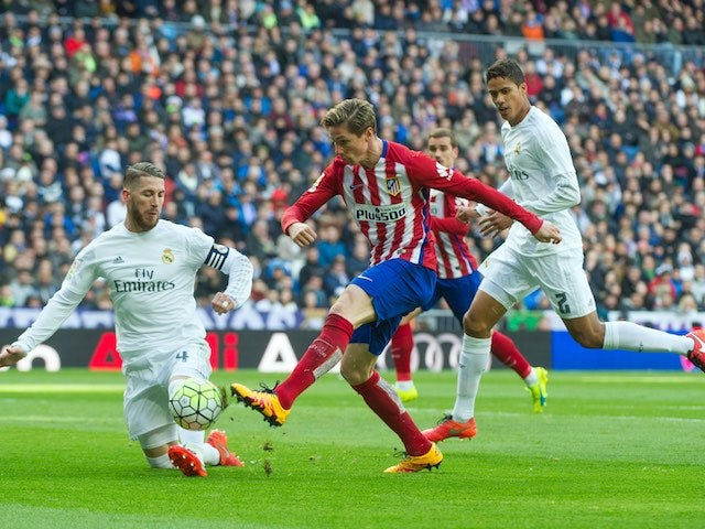 Sergio Ramos, Raphael Varane and Fernando Torres in action during the La Liga game between Real Madrid and Atletico Madrid on February 27, 2016
