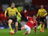 Ander Herrera slides in to tackle Valon Berami during the Premier League match between Manchester United and Watford at on March 2, 2016