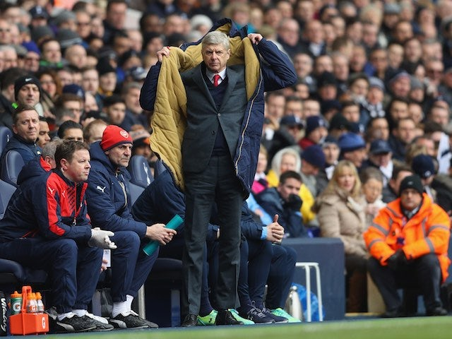 Arsene Wenger dons his coat during the Premier League game between Tottenham Hotspur and Arsenal on March 5, 2016