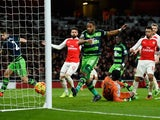 Ashley Williams of Swansea City scores his side's second goal against Arsenal on March 2, 2016