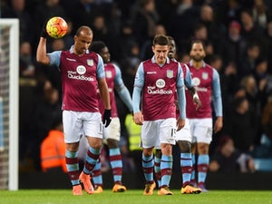 Aston Villa players look dejected during the Premier League game between Aston Villa and Everton on March 1, 2016