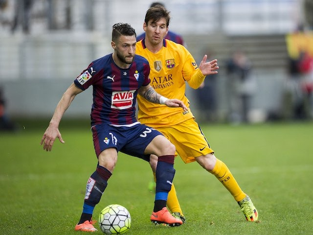 David Junca 'inyatrunca' and Lionel Messi in action during the La Liga game between Eibar and Barcelona on March 6, 2016