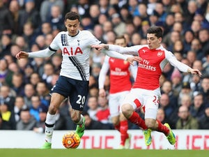 Dele Alli and Hector Bellerin in action during the Premier League game between Tottenham Hotspur and Arsenal on March 5, 2016