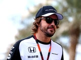 Fernando Alonso of McLaren Honda arrives in the paddock before final practice for the Abu Dhabi Grand Prix at Yas Marina Circuit on November 28, 2015