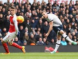 Harry Kane takes a shot past Gabriel during the Premier League game between Tottenham Hotspur and Arsenal on March 5, 2016