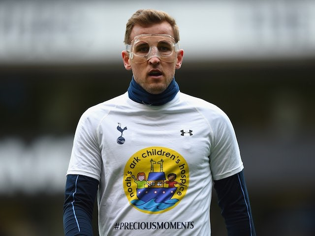 Harry Kane and his large, broken nose warm up ahead of the Premier League game between Tottenham Hotspur and Arsenal on March 5, 2016
