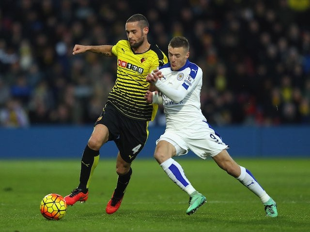 Jamie Vardy tussles with Mario Suarez during the Premier League game between Watford and Leicester City on March 5, 2016