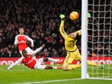 Joel Campbell scores the opening goal during the Premier League match between Arsenal and Swansea City at the Emirates Stadium on March 2, 2016