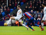 Jordan Henderson evades Wilfried Zaha during the Premier League game between Crystal Palace and Liverpool on March 6, 2016