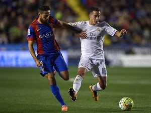 Jose Luis Morales competes for the ball with Lucas VAZQUEZ during the La Liga match between Levante and Real Madrid on March 02, 2016