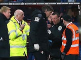 Kevin Friend receives treatment during the Premier League game between Bournemouth and Southampton on March 1, 2016