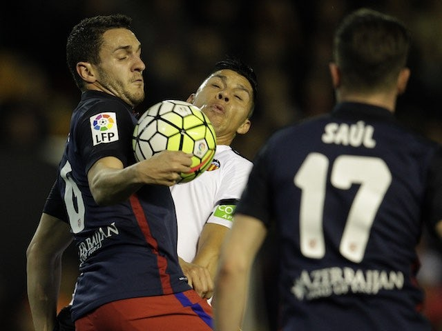 Koke and Enzo Perez clash during the La Liga game between Valencia and Atletico Madrid on March 6, 2016
