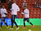 Raheem Sterling warms up at Anfield ahead of the Premier League game between Liverpool and Manchester City on March 2, 2016