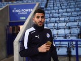 Riyad Mahrez shows off his gold iPhone ahead of the Premier League game between Leicester City and West Bromwich Albion on March 1, 2016