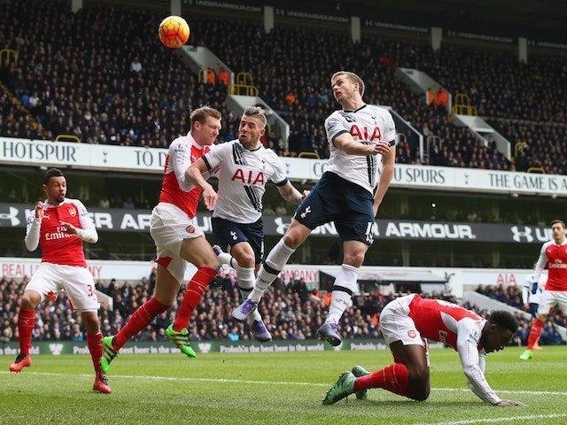Toby Alderweireld, Eric Dier and Per Mertesacker jump for the ball during the Premier League game between Tottenham Hotspur and Arsenal on March 5, 2016