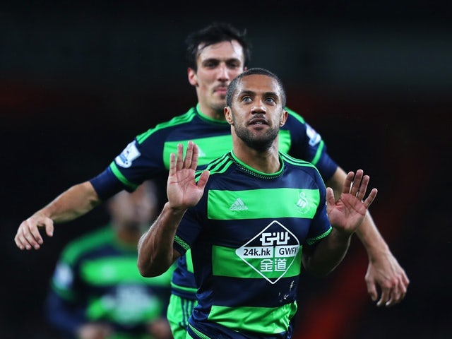 Wayne Routledge of Swansea City celebrates scoring the equalising goal against Arsenal on March 2, 2016