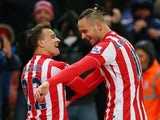 Xherdan Shaqiri celebrates scoring with Marko Arnautovic during the Premier League game between Stoke City and Newcastle United on March 2, 2016