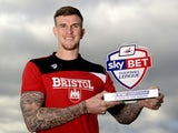 Aden Flint poses with his player of the month award for February 2016