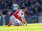 Alexis Sanchez takes a breather during the FA Cup game between Arsenal and Watford on March 13, 2016