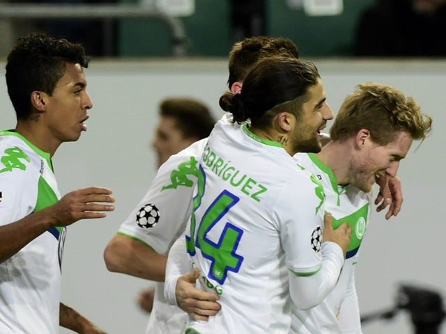 Wolfsburg's striker Andre Schurrle and teammates react after scoring during the second-leg round-of-16 Champions League match against Gent on March 8, 2016